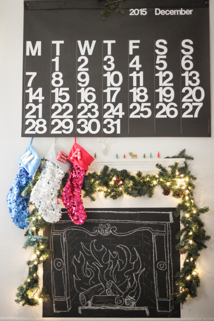 Faux Fireplace DIY | Create ambience and coziness with this chalkboard fireplace tutorial https://chasingmcallisters.com/faux-fireplace-diy